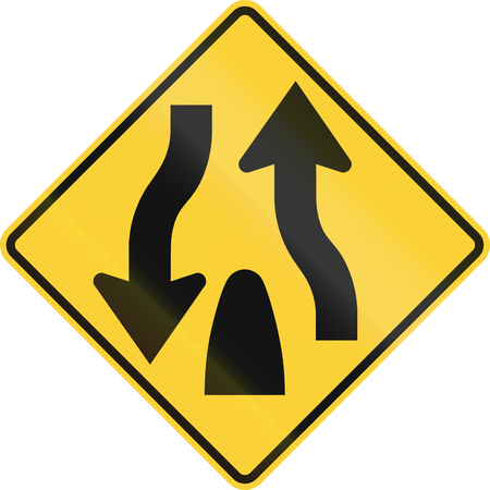 the carriageway: United States MUTCD road sign - End of dual carriageway.