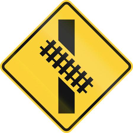 railtrack: United States MUTCD road sign - Diagonal level crossing. Stock Photo