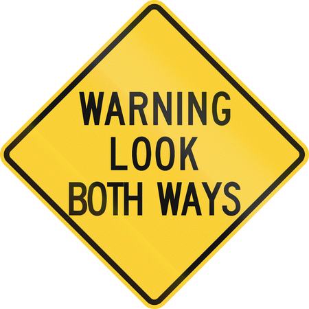 both: Road sign used in the US state of Nebraska - Warning - Look both ways.
