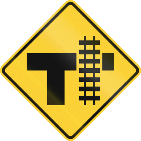intersection: United States MUTCD road sign - Level crossing and intersection. Stock Photo