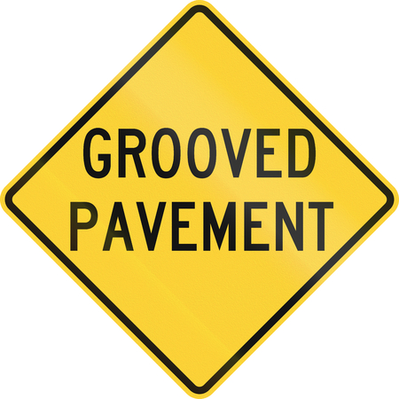 grooved: United States MUTCD road sign - Grooved pavement. Stock Photo