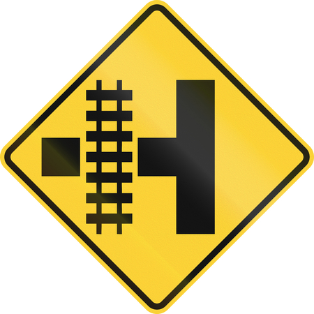 t square: United States MUTCD road sign - Level crossing and intersection. Stock Photo