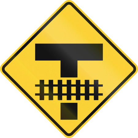 intersection: United States MUTCD road sign - Intersection and tracks.