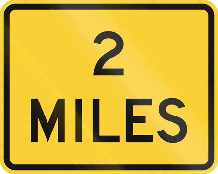 auxiliary: United States MUTCD warning road sign - 2 Miles. Stock Photo