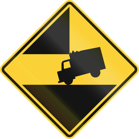 Road sign in the United States warning drivers of high vehicles that there is a dangerous clearance ahead.