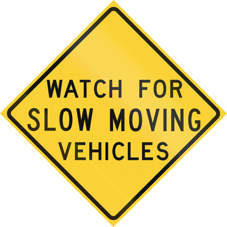 slow: Road sign used in the US state of Texas - Watch for slow moving vehicles. Stock Photo