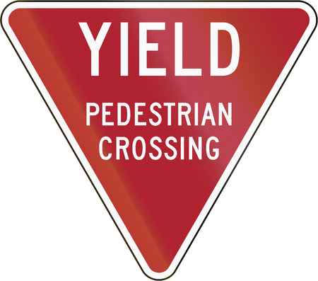 yield: Yield To Pedestrian Crossing sign in the United States.