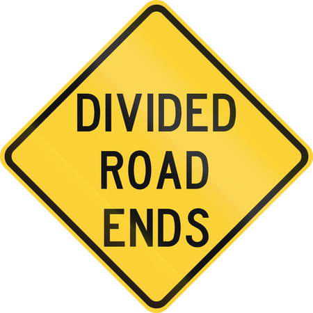 the divided: Road sign used in the US state of Texas - Divided road ends. Stock Photo