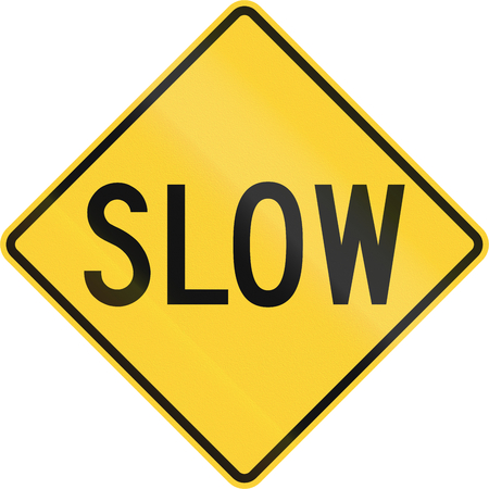 slow down: Road sign in the United States warning drivers to proceed slowly or slow down. Stock Photo