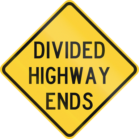 median: Road sign used in the US state of Texas - Divided highway ends. Stock Photo