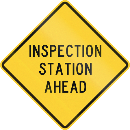 danger ahead: Road sign used in the US state of Texas - Inspection station ahead. Stock Photo