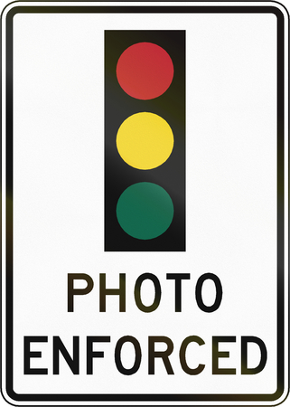 amber light: Road sign used in the US state of Virginia - Traffic lights photo enforced.
