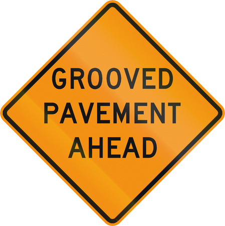 grooved: Road sign used in the US state of Virginia - Grooved pavement ahead. Stock Photo