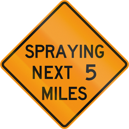 spraying: Road sign used in the US state of Virginia - Spraying next 2 miles. Stock Photo