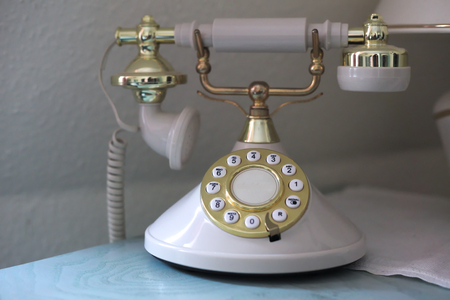 dial plate: Vintage phone with a golden dial plate.