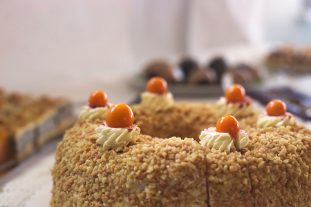 ground cherry: Cake with almonds and ground cherry on top. Stock Photo