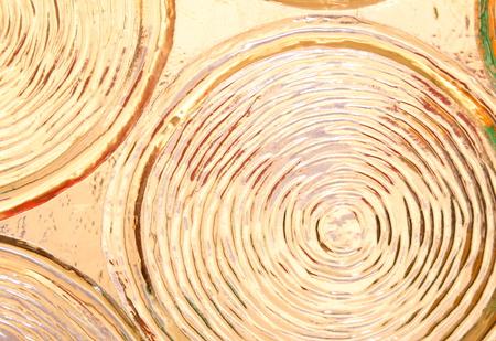 pane: Macro of light effects in an ornamental glass pane.