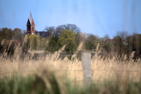 greifswald: Bugenhagen church in Greifswald-Wieck, Germany with selective focus and blue sky.