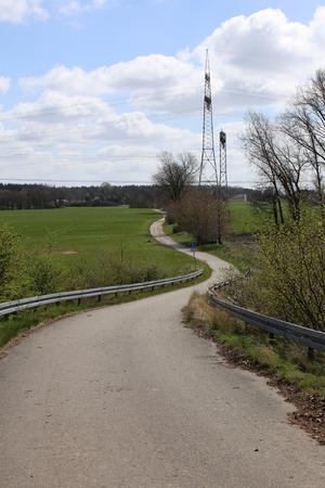 voltage gray: Road in agricultural landscape in Mecklenburg-Vorpommern, Germany. Stock Photo