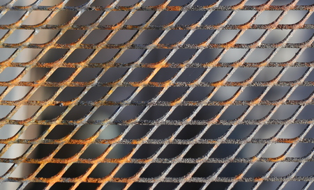 grate: Close up of a slightly rusty cooking grate.