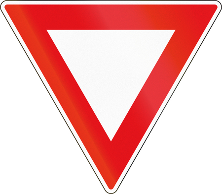 yield sign: Road sign used in the African country of Botswana - Yield. Stock Photo