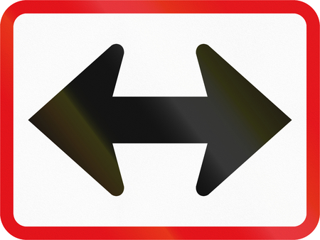 both: Road sign used in the African country of Botswana - The primary sign applies to the left and right.