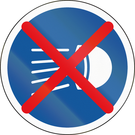 Road sign used in the African country of Botswana - Switch headlamps off.