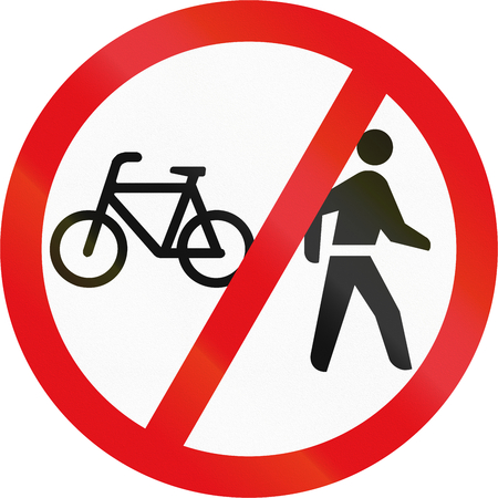 pedestrians: Road sign used in the African country of Botswana - Cyclists and pedestrians prohibited. Stock Photo