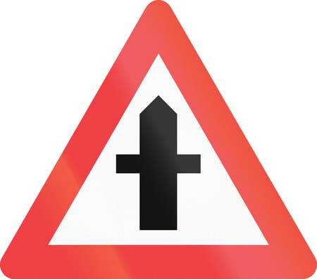 Warning road sign used in Denmark - Crossroads with priority. Stock Photo