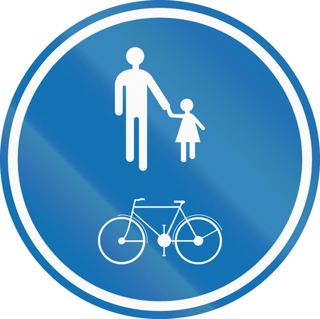 Belgian regulatory road sign - Compulsory track for pedestrians, cyclists and moped drivers. Stock Photo
