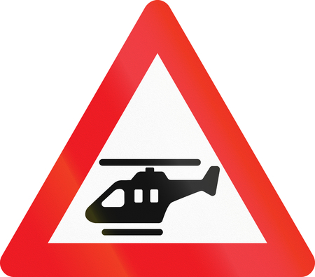 helicopters: Warning road sign used in Denmark - Low-flying helicopters. Stock Photo