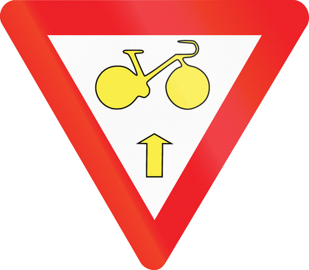 Belgian regulatory road sign - Cyclists may continue straight ahead in spite of red light. Give way. Stock Photo