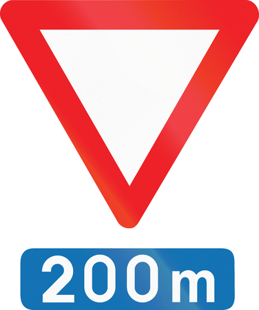 give: Belgian regulatory road sign - Give way in 200 meters. Stock Photo