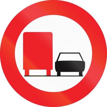 overtaking: Belgian regulatory road sign - No overtaking for trucks. Stock Photo