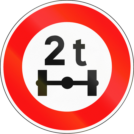 axle: Road sign used in France - No vehicles having a weight exceeding 2 tonnes on one axle. Stock Photo