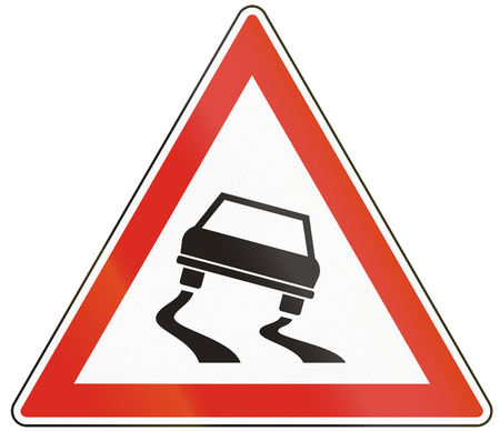 Hungarian warning road sign - Slippery road. Stock Photo