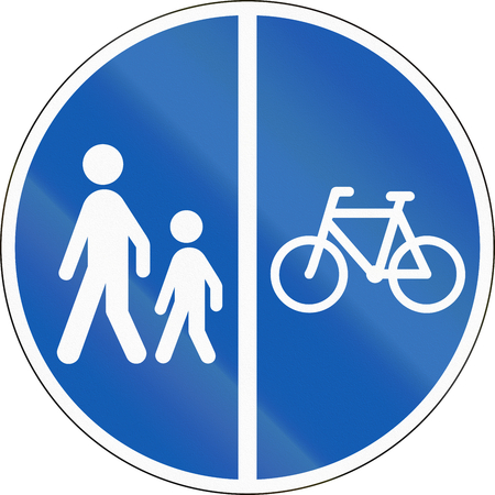 Road sign used in Denmark - Separate lanes for pedestrians and Cyclists. Stock Photo