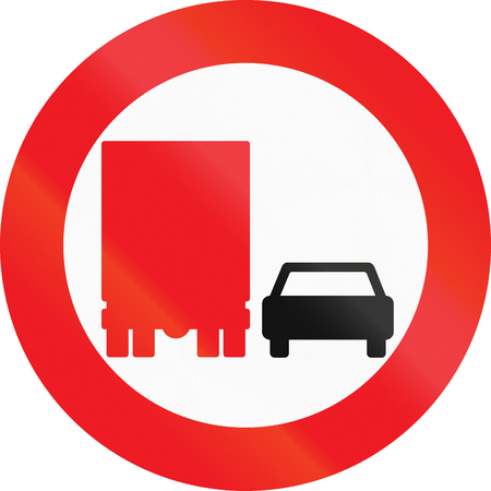 passing the road: Road sign used in Denmark - No overtaking by lorries. Stock Photo