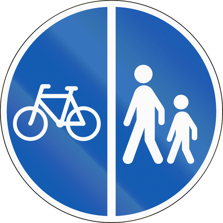 pedestrians: Road sign used in Denmark - Separate lanes for pedestrians and Cyclists. Stock Photo