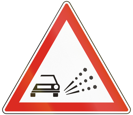 loose: Hungarian warning road sign - Loose chippings.