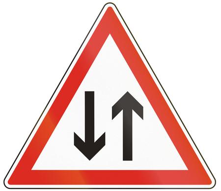 opposing: Hungarian warning road sign - oncoming traffic.