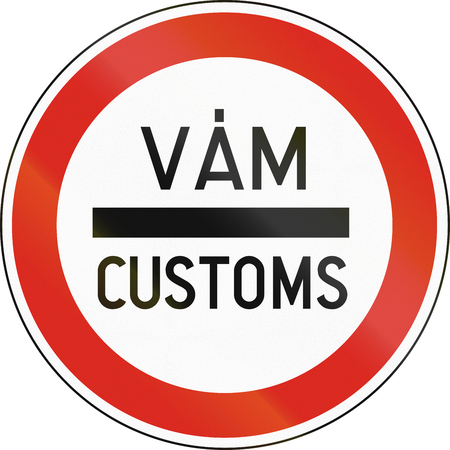 bilingual: Road sign used in Hungary - Stop for customs. The words means customs in Hungarian and English. Stock Photo