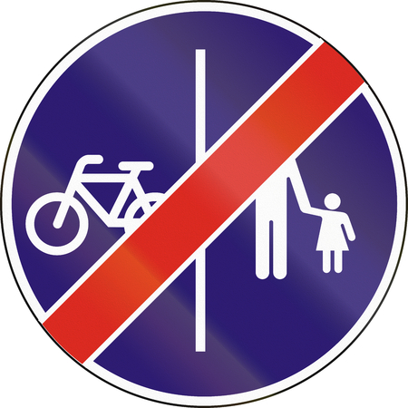 Road sign used in Hungary - End of separate lanes for pedestrians and Cyclists. Stock Photo