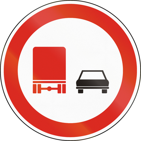 passing the road: Hungarian regulatory road sign - No overtaking for trucks. Stock Photo