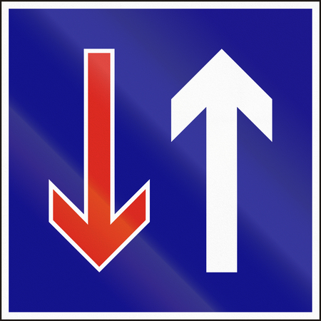 opposing: Hungarian regulatory road sign - Priority over oncoming vehicles. Stock Photo