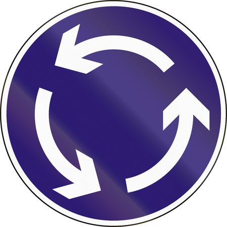 roundabout: Road sign used in Hungary - Roundabout.