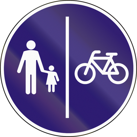 pedestrians: Road sign used in Hungary - Separate lanes for pedestrians and Cyclists. Stock Photo