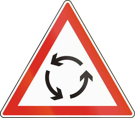 roundabout: Warning road sign used in Hungary - Roundabout warning.