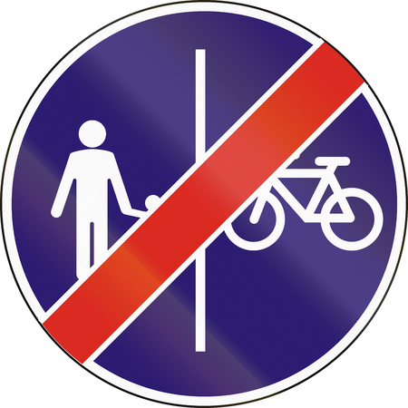 pedestrians: Road sign used in Hungary - End of separate lanes for pedestrians and Cyclists. Stock Photo