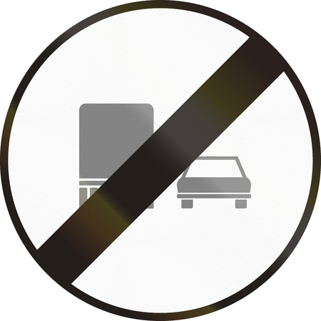 two objects: Hungarian regulatory road sign - End of no overtaking for trucks. Stock Photo